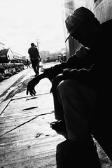 Man Sits In The Sun (Meljoe San Diego) Tags: meljoesandiego ricoh grd4 grdiv streetphotography people candid monochrome alaminoscity philippines