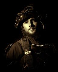 LV_Michael_03sepia_8x10 (TNrick) Tags: lasvegas portrait man freemontstreet swordsman grid speedlight yongnuo topaz