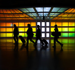 Voyagers (Greg Adams Photography) Tags: ohare airport chicago chicagoohare illinois silhouettes people travels travellers lights light panels terminal passage lines geometry suitcase business vacation hhsc2000 theskysthelimit