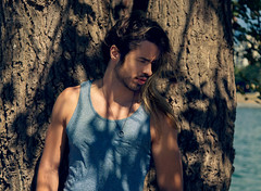 (Wendy Lu.) Tags: wendylu canon5d vanier park vancouver british columbia tree shaded sunny day male portrait man long hair tanktop necklace windy focused cool ocean beach