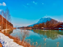 Sunny winter day in the river Inn valley with Zahmer Kaiser mountain, Tyrol, Austria (UweBKK (α 77 on )) Tags: sunny winter day river inn valley water flow reflection zahmer kaiser mountain alps sky blue austria österreich tyrol tirol europa europe iphone trees