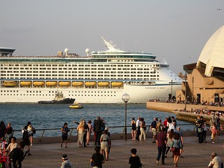 Sydney. Circular Quay. Voyager of the Seas turns apst the Opera House. View from Matt Moran's Aria Restaurant dining table.
