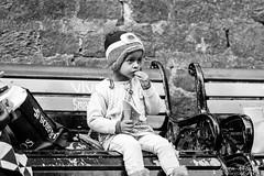 Little World, Little Indulgences (PB1_0337) (Param-Roving-Photog) Tags: child kid girl little cute sweet innocence snack street food fries content bench walk shopping tourist mall shimla streetphotography candid nikon nikkor monochrome bw blackandwhite shooping bags