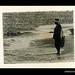 Photograph by Oskar Speck depicting a man fishing