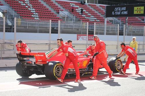 Sebastian Vettel's car is pushed back down the pit lane at Formula One Winter Testing 2018