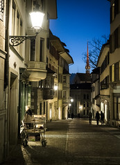 Switzerland 05 (arsamie) Tags: suisse swiss street urban city center night book old lady calm serenity town europe cold winter light perspective life kirchgasse zurich books bookstore