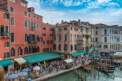 On The Grand Canal (Jill Clardy) Tags: europe italy venice canals 20110902img2650 grand canal hotel rialto crowds crowded people pier awnings walking architecture buildings italian tourists tourism