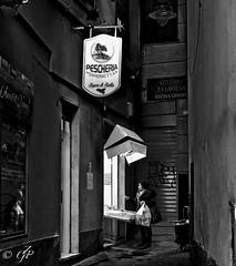 """Street Market"" (giannipaoloziliani) Tags: nikoncamera nikonphotography nikon flickr capture capturestreets dark darkness liguria lightandshadow italia italy vicolidigenova vicoli genova genoa sale shop periphery suburbs streetphotography biancoenero blackandwhite raw"