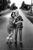 Tiny and Pat on a road, Seattle, 1993 (santinoaugi1) Tags: 150dpi 1990s 1993 35mm 400 404v 404v002016 404v002016tif 90s 93 adolescent adolescents america arm armaround arms armsaround around blackwell bw daughter daughters embrace embracing erin erinblackwell exterior female journalism journalistic may mother motherhood mothers negative nineties north northamerica pair pairs pat patrappel patricia patriciarappel photojournalism portrait portraiture rappel road roads seattle snuggle snuggling states street streets teen teenager teenagers teens tiny tinynightline unassigned united unitedstates unitedstatesofamerica us usa v wa washington