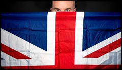 The Flag and I. (CWhatPhotos) Tags: cwhatphotos pose portrait unionjack flag redblueandwhite redwhiteblue digital camera pictures picture image images photo photos foto fotos that have which contain olympus penf lens uk colors color colour colours eyes me look behind self selfie portraited