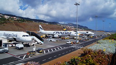 All lined up (Steenjep) Tags: madeira portugal ferie holiday urlaub funchalairport airplane airfield runway truck landscape sky thomascookairlines thomascook airbus a321 oytcd oytce finnair boeing 737