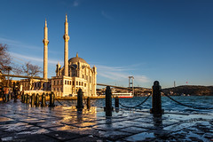 Middle village... (The Frustrated Photog (Anthony) ADPphotography) Tags: architecture category external hdr istanbul ortakoy places travel turkey bosphorus bridge mosque placeofworship famousplaces water waves sunset sky bluesky puddles paving reflections reflectedlight outdoor travelphotography architecturephotography canon1585mm canon70d canon