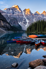 The Colours of Morning (Kristin Repsher) Tags: alberta alpenglow banff banffnationalpark canada canadianrockies canoes d750 morainelake mountains nikon reflections rockies rockymountains sunrise ca