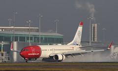 Reverse Thrust (Treflyn) Tags: norwegian boeing 737800 737 738 lndyg jenny lind livery spray landing manchester airport flight oslo reverse thrust