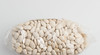 Navy beans. (annick vanderschelden) Tags: navybean haricot pearlharicotbean bostonbean whitepeabean peabean commonbean phaseolusvulgaris america dry white oval flattened shape baked nutritious fat carbohydrates starches protein