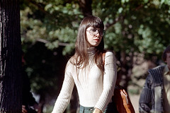 55-171 (ndpa / s. lundeen, archivist) Tags: nick dewolf nickdewolf photographbynickdewolf 1974 1970s color 35mm film 55 reel55 boston massachusetts ma cambridge park common cambridgecommon people youngpeople woman youngwoman girl brunette longhair glasses eyeglasses sweater turtleneck turtlenecksweater bag shoulderbag purse bangs 1973