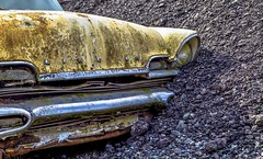 Rock Slide (Paul Rioux) Tags: automobile auto vehicle car lincoln old classic vintage abandoned discarded forgotten delapidated decay decaying decayed patina rust rusty rusting rock slide buried prioux gravel