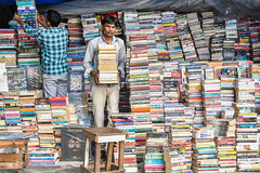 Street Books (roevin | Urban Capture) Tags: mumbai maharashtra india in city urban center street area downtown book books stack stacks seller man stacked colors carrying fullyfilled magazines stall market chair pavement organized