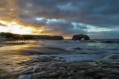 Yesterday Morning (Omnitrigger) Tags: waterflow beach sand arch feature hightide sunrise sun sunflare water ocean pacific naturalbridges santacruz