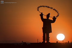 And for my next trick. (alundisleyimages@gmail.com) Tags: pierrotclown newbrightom wirral merseyside monument statue welcome sculpture poprtsandharbours silhouettes promenade strollers weather sunset snowdoniamountains beach sea cars england uk rivermersey