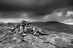 Harter Fell Cairn (Benjamin Driver) Tags: lakedistrict hardknott hardknottpass cumbria england hill hills mountains mountain blackandwhite black white monocrome cairn clouds cloud contrast symetry