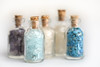 In a Bottle (PhotosbyDi) Tags: macromondays inabottle bottles miniature crystals amethyst bluetopaz turquoise nikond600 tamronf2890mmmacrolens rosequartz crystal