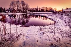 Monyash (MarkandJackiephotos) Tags: purple pond water houses bushes lights reflections derbyshire winter