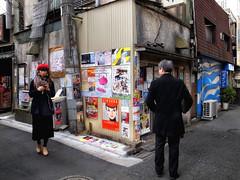 Downtown Tokyo 13 (luckyandbird) Tags: richogrd snapshot portrait man woman posters tokyo japan evening