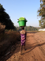 Dish Duty (Drew Makepeace) Tags: guinea dishes girl kouande bucket tasaba road