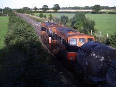 162 & 169 on Waterford-Northwall cement train at Kearneystown 15-Sept-06 (metrovick) Tags: irishrail iarnrodeireann ie141class ie162 cementtrain freighttrain railroad railway railwaykildare emd emdexportloco jl8 kearneystownbridge