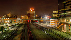 Rails through Kansas City (T P Mann Photography) Tags: kansas city night long exposure canon missouri reflections lights dark urban signals tracks rails rail bridge transportation