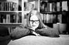 (aLMachtunG) Tags: 35mm analog film portrait woman wife bookshelf nikon nikonf3 kodak kodaktrix blackandwhite