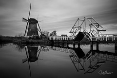 A bridge to a mill (cornelis1980) Tags: bridge mill water holland kinderdijk landscape black white monochrome heritage long exposure