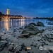 An evening scene of a river landscape in the Netherlands at the town of Deventer