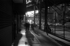 Sunset at Roosevelt Ave (Rafakoy) Tags: ilfordfp4125 ilford fp4 125 kodakhc110dilutionb kodak hc110 dilutionb developer newyork selfdeveloped blackandwhite ny film yashicaelectro35 shadows sunset light natural people city urban train exposure