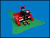 Quiet read in the park (Karf Oohlu) Tags: lego moc parkbench bot robot droid botonabench