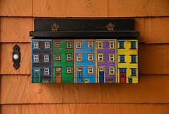 Halifax Row House Mailbox (Katrina Wright) Tags: novascotia dsc4104 halifax mailbox letterbox doorbell wood decoration folkart crafts 5 3 7 4 5374 door entry siding line