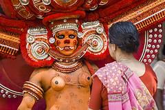 The Theyyam God and the Seeker of God (Anoop Negi) Tags: theyyam live god kerala india kannur kottayampovil culture religion animistic dance dancing red street kozhikodedanceformancientindianphotophotographredanoopnegiezee123photosphotosofimageimagesimagesofphotographyfordelhimumbaibangalorebestportrai notes andpeopletagspeopleyoufollowsetsafetylevelsafe