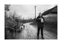 Bottle of milk (Jan Dobrovsky) Tags: carpathians portrait smile people reallife milk countryside road monochrome bottle outdoor leicaq village blackandwhite ukraine mud horse countrylife document