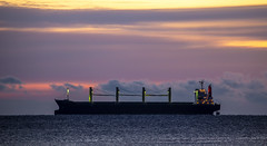 Basic Brave (Paul Rioux) Tags: marine ship boat vessel commercial freighter basicbrave bulkcarrier morning dawn daybreak sunrise dark clouds cloudy orange sea ocean prioux canon 6d ef100400f4556lisiiusm