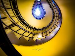 bulb staircase (markmeyerzurheide) Tags: stairs spiral architecture czech city house town light shadow illuminate prague czechrepublic staircase stairway architektur cz olympus olympuscamera bulb artisticphotography mzh omd oriental café travel explore brenziner methode effect checkthisout yellow blue