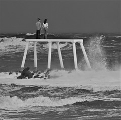 Couple Statue - Water and Waves - Black and White (Gilli8888) Tags: newbigginbythesea newbiggin northumberland seaside sea northsea northeast winter snow nikon p900 coolpix blackandwhite statue art couplestatue sculpture publicart waves seascape rocks seaspray spume monochrome coast coastal water