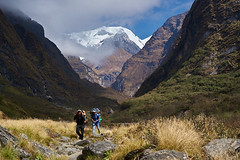 Nepali porters walking down Modi Khola river valley, Annapurna massif, Nepal (Alex_Saurel) Tags: landscape cascade snowcappedmountains himalayarange annapurnamassif portage asie porteurs culture 35mmprint people roches carrying scans porter chaînehimmalayenne neige nepaliporters snow asian pattern work rocks motif action himalaya asia mountainrange montagne summit travel lifescene paysage annapurnabasecamptrek grass imagetype peak photospecs photoreport mountain abctrek vallée annapurna photoreportage अन्नपूर्णा herbe reportage annapurnaconservationarea stockcategories photojournalism nature day traditional time sommet tradition nepal scènedevie lifestyles sony50mmf14sal50f14