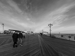 Boardwalk Stroll (deepaqua) Tags: brooklyn lenstagger amusementpark offseason winter coneyisland cloud street streetlamp goldenhour boardwalk beach