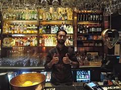 Thumbs up (Alizarin Krimson) Tags: bottles bartender beerista thumbsup portrait drinks restaurant bar pub