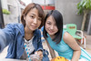 Young women taking selfie picture at outdoor cafe (Apricot Cafe) Tags: img36991 asia asianandindianethnicities cafe japan japaneseethnicity shibuyaward sigma20mmf14dghsmart tokyojapan beautifulwoman blackhair brownhair buildingexterior candid carefree casualclothing charming cheerful citylife colorimage communication connection day enjoyment foodanddrink friendship happiness harajukudistrict leisureactivity lifestyles lookingatcamera lunch onlyjapanese onlywomen onlyyoungwomen outdoors people photography restaurant selfie shopping sleeveless smiling straighthair student togetherness toothysmile twopeople women youngadult