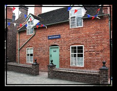 Photography (Audrey A Jackson) Tags: canon60d blistshill ironbridge livingmuseum photographyshop windows door advertising wall pillars drainpipes 1001nights