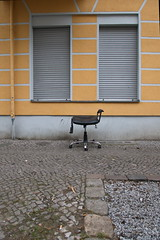 Please take a seat 622 (österreich_ungern) Tags: lost abandoned seat chair berlin 44 trash decay müll büro stuhl broken battered plastic yellow collection frontal street urban windows closed lines pipe