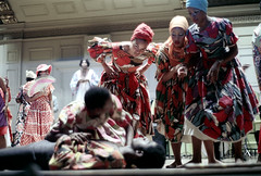 55-581 (ndpa / s. lundeen, archivist) Tags: nick dewolf nickdewolf photographbynickdewolf 1974 1970s color reel55 55 35mm film boston mass massachusetts symphonyhall stage performance catellitrinidadallstars trindadian ambakaila trinidadcarnivalballetandsteelband trinidad carnival ballet steelband dance dancing dancer dancers costume costumes costumed traditional performer performers show caribbean women youngwomen dress dresses headwrap man men youngman youngmen