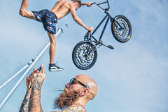 Off Air. (Ldv Müh ♫) Tags: bike riding jump jumping portait movement extreme boat sky summer sun sunlight head beard tatoo bmx style glasses phone photo blue clouds cloud bald canon canoneos70d troyes lake water warm aube champagne france europe world earth planet galaxy universe peace love brotherhood people outside outdoor nature fun funny smoke cigarette